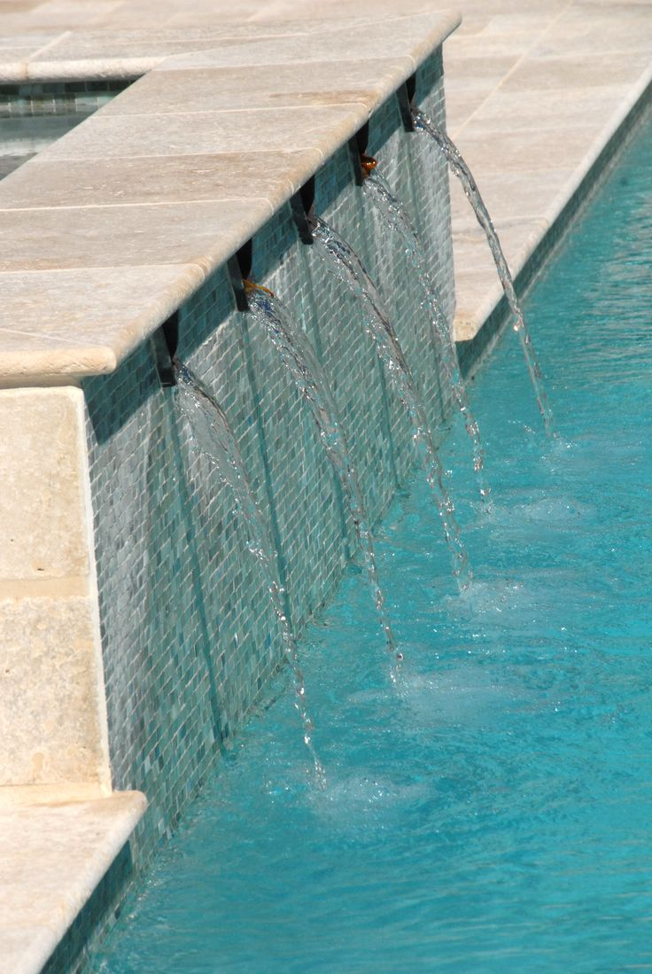 Travertine pool coping and field tile. Vihara glass pool waterline tile. ~ Palatial Stone & Tile
