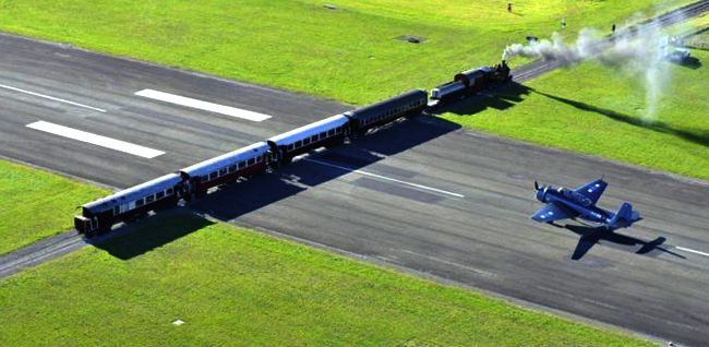 Gisborne Airport, a small regional airport in New Zealand with a few regular commercial flights, has an active rail line bisecting it's runway.