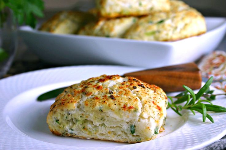 Savory-Ricotta-Scones   Life, Love, and Good Food    2 cups all-purpose flour     1 tablespoon baking powder     ¾ tablespoons sugar     ½ teaspoon salt     5 tablespoons chilled unsalted butter     ½ cup green onions or scallions, chopped     1/4 cup fresh parsley, minced     1 tablespoon fresh thyme leaves     1 teaspoon fresh rosemary, minced     1 cup ricotta cheese     ⅔ cup milk     1 egg, beaten with 1 teaspoon water (for egg wash)     sea salt     black pepper     smoked paprika