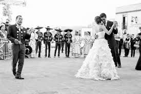 Music: In this picture is a bride and groom dancing with the Mariachi in the back playing music. Mariachi music is very popular music to play in a Mexican wedding.  Mariachi is a French word which means (marriage).