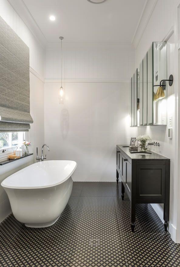Dark patterned tiles classic bathroom