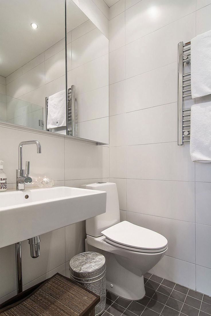 Apartments:Comely Minimalist Bathroom Apartment Design Ideas With White Design Ideas With Mirror Also Faucet Sink And Toilet Also White Towel As Well As Gray Tiles Floor And White Ceramic Walls Cozy and Elegant Scandinavian Apartment Design Decorating: Small Apartment in Stockholm