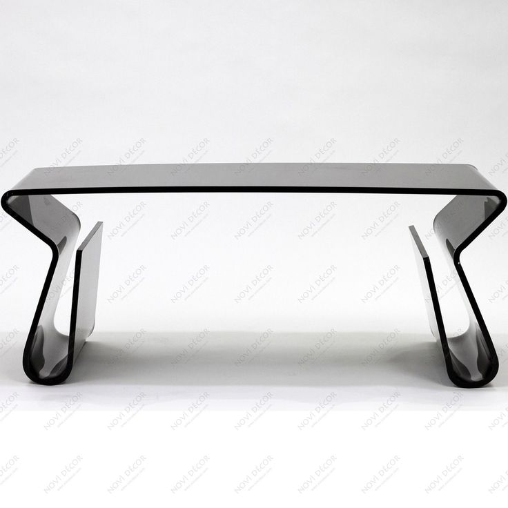 elegance black glass table with refined curvatures and extremely impressive equipped with a storing newspapers and elongated legs