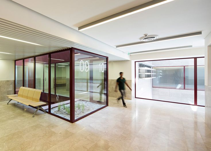 AGi design Cardiac rehabilitation centre on Kuwait Bay. With stone-clad walls and a deep red atrium, this medical centre in Kuwait