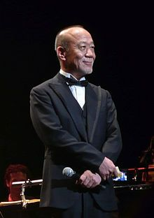 A Wiki page on Joe Hisaishi's  it has his Biography as well are his courier