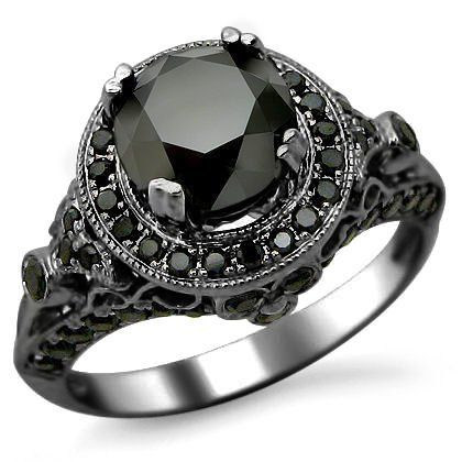 gothic engagement ring, blaxck diamond, black gold ring | InkedWeddings.com