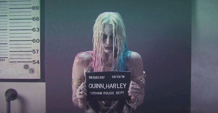 """((Open with Harley)) After that stupid bat got me, I had to take my mugshot, wet. After they finish taking it they give me my prison outfit, pushing me into a room to change. After that happened, they throw me in a cell, which happened to be yours. """"How'd you get in here?"""" I ask, my voice quiet."""