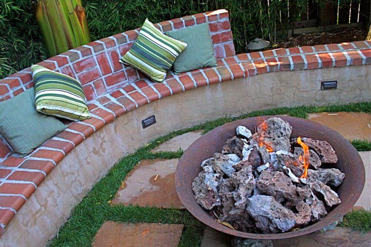 built in bench around fire pit. . . concrete & salvaged brick.