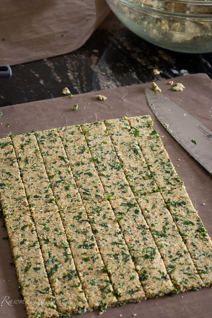 Cheezy Kale Crackers - These taste good and are filling!  Include soaked almonds, kale, coconut flour, kale, spices, flax meal... It's important to get the moisture out so they don't spoil. Try storing in the refrigerator to extend their life.
