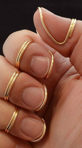 Ok, so these are finger picks, but they're so cool looking, I'd wear them as rings.