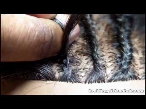 I Slowly Show You How To Braid Cornrows Fast. The video focuses on braiding thin cornrows.