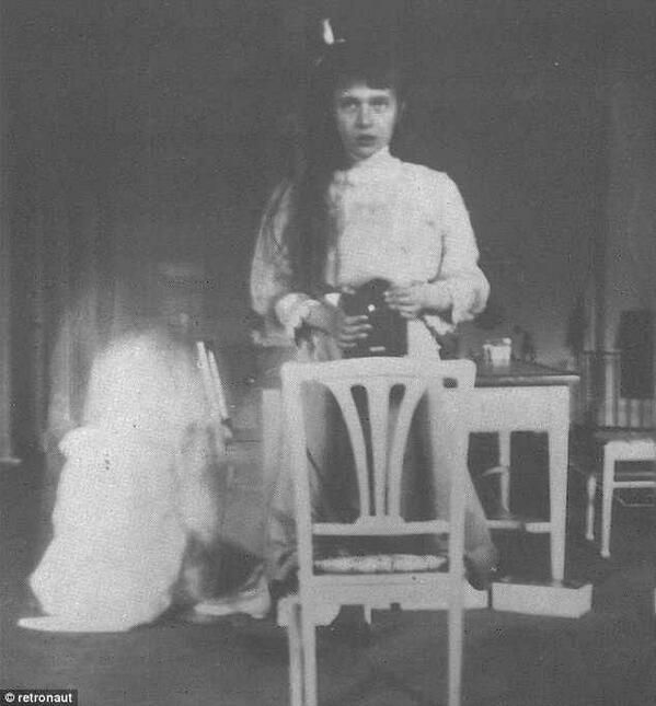 Grand Duchess Anastasia takes a mirror selfie in 1913.
