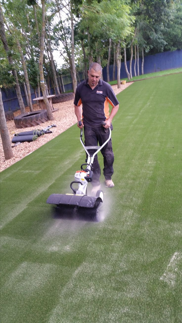 Synthetic Turf maintenance. Sand infill and power brush and spray. Very important to look after your investment for the longevity of the product.