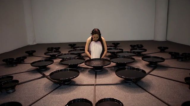 Artist Lisa Park Eunoia II is outfitted with 48 vibration pools, inspired by the 48 emotions philosopher Baruch Spinoza outlined in his book, Ethica, like frustration, excitement, engagement, and meditation. Each speaker vibrates according to Park's brain wave-interpreting algorithm, which tranforms intense signals from Park's Emotiv EEG headset into intense vibrations in the pools of water.