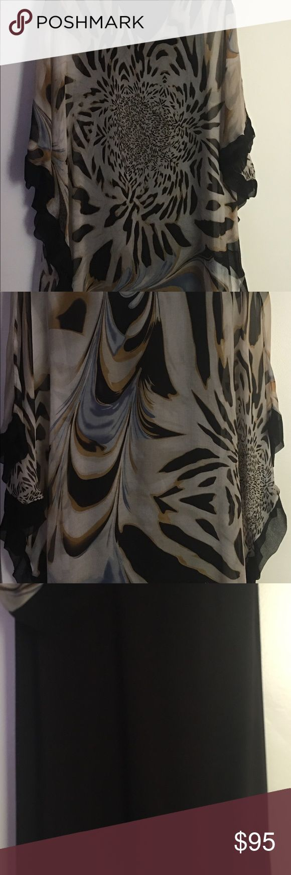 Silk dress 100% silk dress it has a tight spandex /spanx slip attached to the dress.  The size is XS/S . Super flattering, gives good cleavage and shapes the body with 100% flowing  silk animal print. Bought at a upscale Scottsdale boutique. Analili Dresses Mini