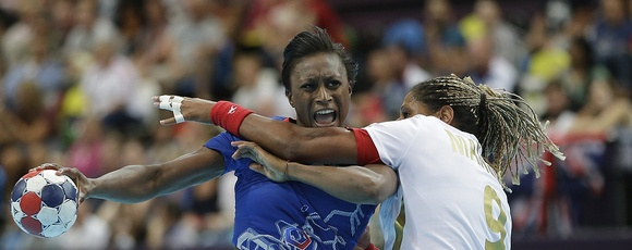 Siraba Dembele of France, left, and Marta Mangue of Spain challenge during their women's handball preliminary match at the 2012 Summer Olympics, Monday, July 30, 2012, in London. (AP Photo/Matthias Schrader)