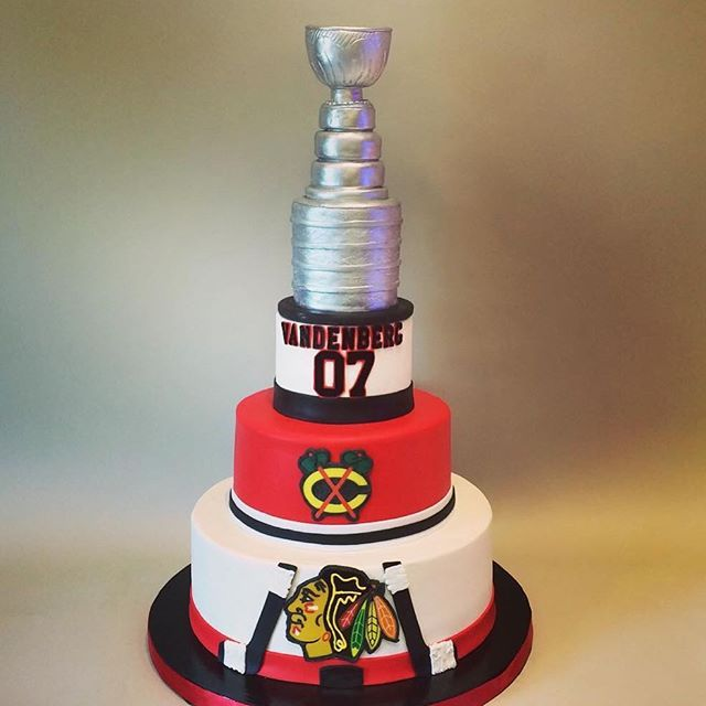 Black hawks wedding cake with a Stanley Cup topper! ~ by Creative Cakes in Tinley Park, IL www.realbuttercream.com
