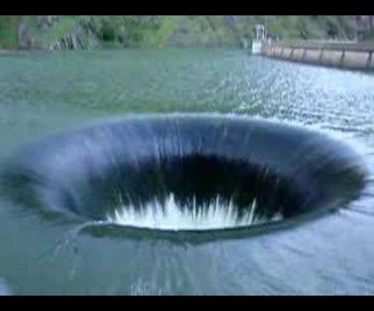 "An actual Black Hole exists on the face of the earth. This ""Glory Hole"" is associated with the Monticello Dam at Lake Berryessa in Napa County, CA and is designed to handle a maximum of 1,370,319 litres of water per second."