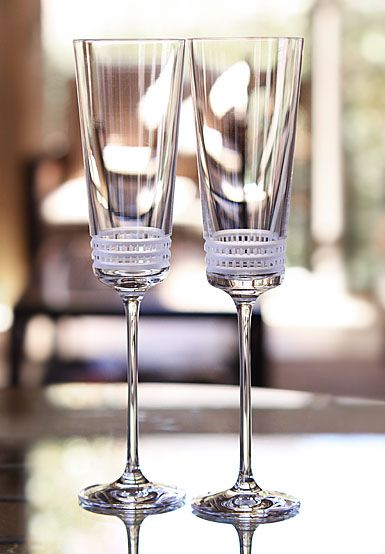 """Lalique Facet Champagne Flute   $160.00 each 10""""   Item# 1594300  Whether around the bar or invited to your table, the """" Facet"""" glasses combine aesthetics to functionality. Their pattern of sober and ultra-contemporary lines magnify the brightness of crystal."""