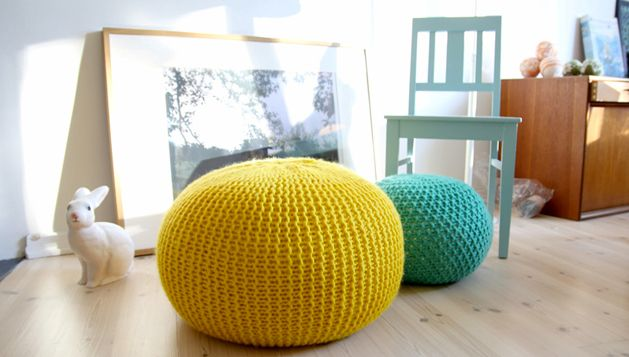 """Giant puff """"Puff Daddy"""" from Pickles.com. """"We really like the pouf from Christien Meinderstsma, but it´s way out of our price range. This simple pattern for a knitted stool has much thinner yarn, but the budget is just as thin;) Nice to rest your legs on, and very popular for the kids."""""""