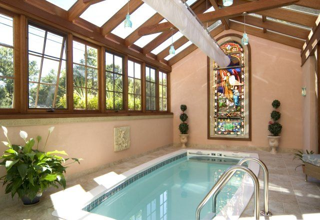 Indoor swimming pool! In a conservatory! With a stained glass window!