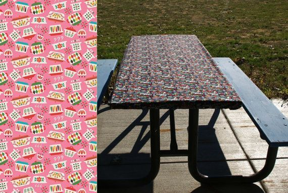 Kid-proof, wind-proof, pet-proof tablecloth doesn't need any clips to keep it from shifting or blowing away. Fitted table cover in 6 or 8 foot lengths. Perfect for folding tables and picnic tables. Vintage Pyrex dishes print on pink.