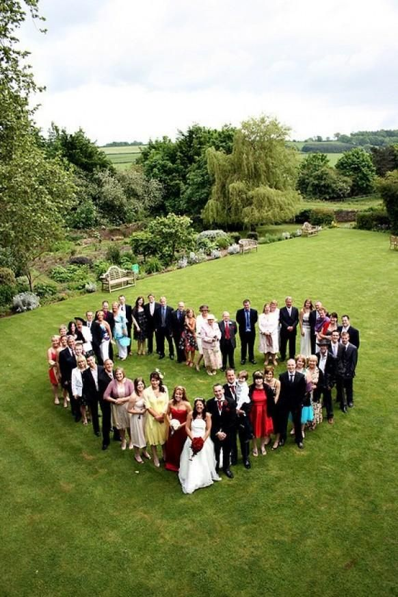 You could have the bridesmaids and groomsmen form a heart by holding hands and have the groom and bride laying or standing in the middle.