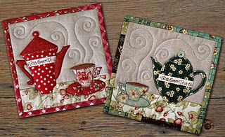 I like the quilting lines that show steam rising from the teacups and teapots.