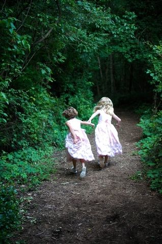 .A good beginning to a story - a little girl ushering her friend into the forest