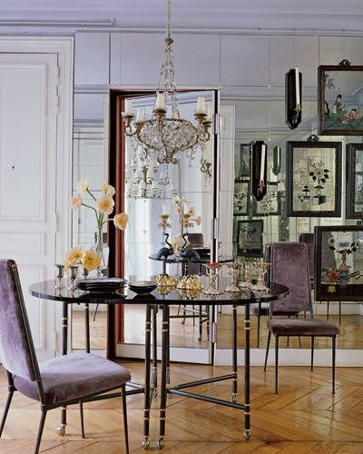 Glam Dining Room- mirrored walls, purple velvet chairs and herringbone wood floor. Lisa Fine Interiors.