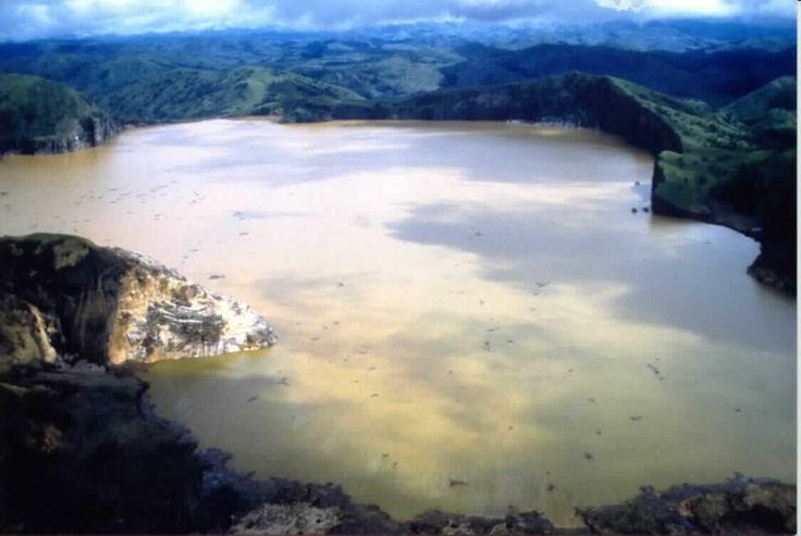 Lake Nyos, in West Africa:  Deep in the lake bed lies a pocket of magma that has been leaking carbon dioxide. At the end of the summer of 1986, the lake became depressurized, and the carbon dioxide rushed to the surface killing more than 1,700 people in its wake. - via http://upload.wikimedia.org/