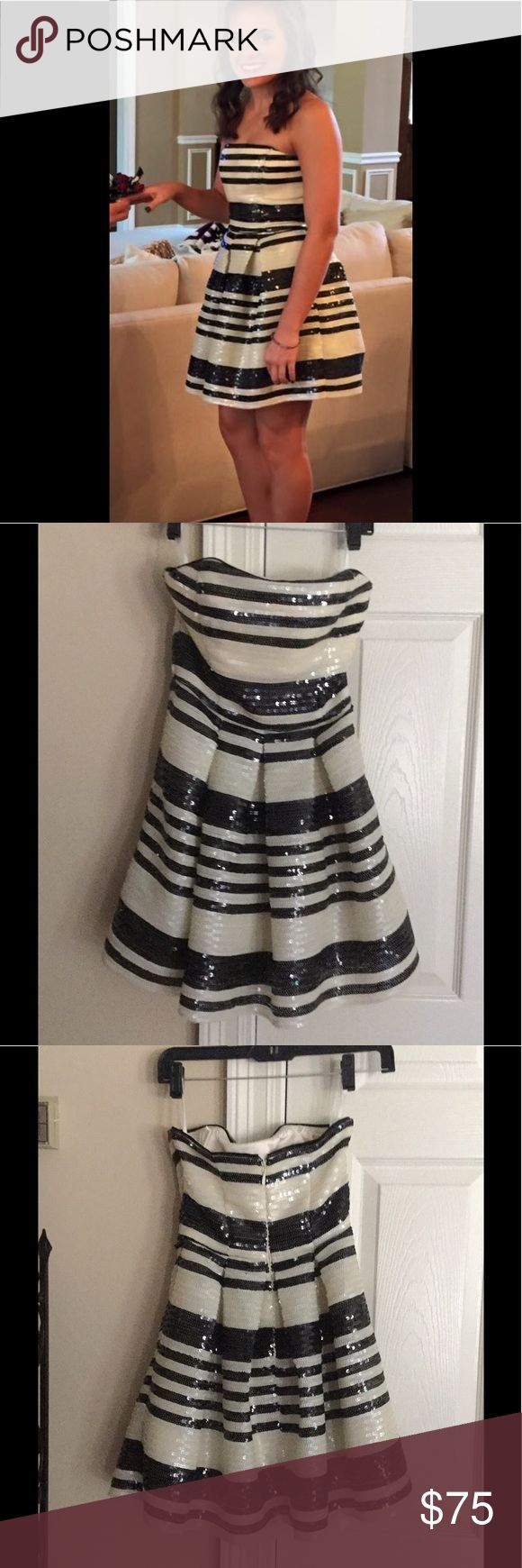 Homecoming/Semi formal dress Worn one time!  Excellent condition! Gorgeous black and off white strapless sequenced dress. Wear to a Homecoming, wedding, or semi formal/formal event or cocktail! Dresses Prom
