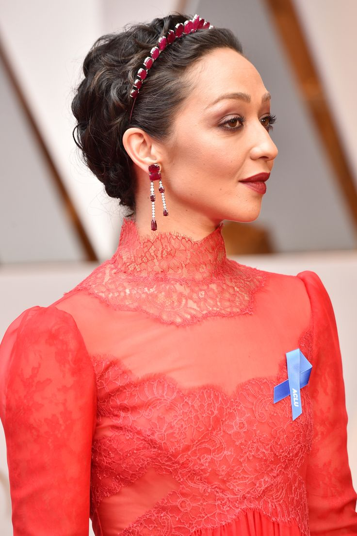 All eyes were on Ruth Negga as she arrived on the red carpet in the most colourful look of the night: an Irene Neuwirth headpiece, earrings and ring set with Gemfields rubies. See the best jewellery moments on the red carpet of the Oscars 2017 worn by all the celebrity stars in high fashion and luxury: http://www.thejewelleryeditor.com/jewellery/top-5/oscars/ #jewelry
