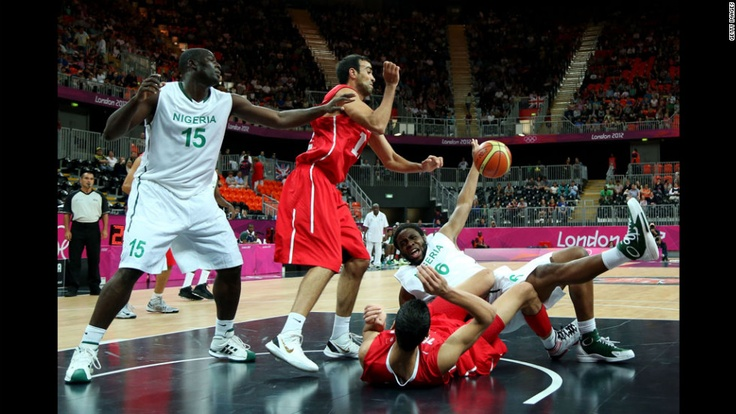 Nigeria's Ike Diogu, No. 6 in white, collides with Tunisia's Salah Mejri, No. 15 in red, during their men's basketball game. http://www.PaulFDavis.com/success-speaker (info@PaulFDavis.com)