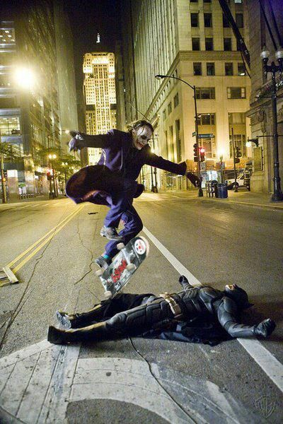Heath Ledger skateboarding over Christian Bale during a break from shooting Batman.