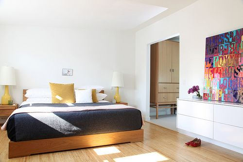 light-filled bedroom, with punch from the bright piece of art