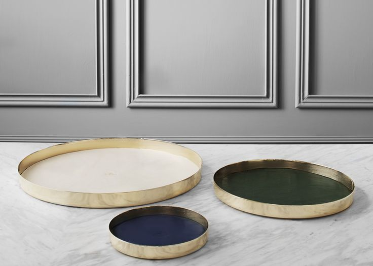 Copenhagen studio GamFratesi has created a collection of spun-brass trays with leather surfaces for Swedish metal company Skultuna