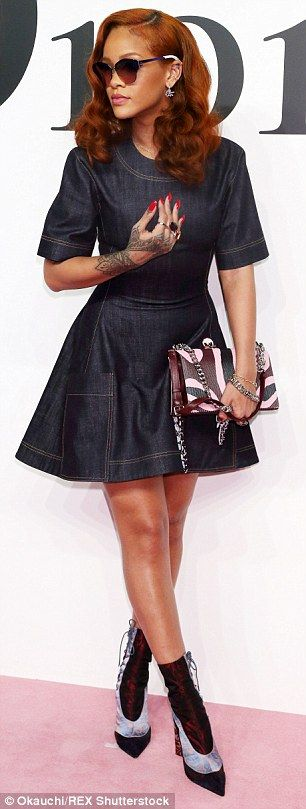 Head to toe: Rihanna added lace-up boots and a printed, chain-length bag from Dior to fini...