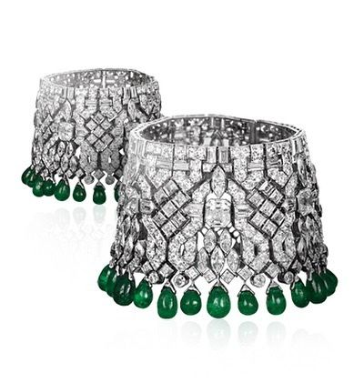 "A remarkable pair of Art Deco emerald and diamond bracelets , convertible to a ""Collier de Chien"" made in 1926/28 by Van Cleef & Arpels."