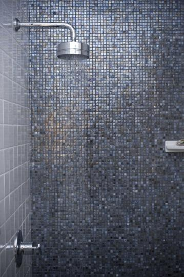 Beautiful use of blue tile mosaics in checkerboard pattern. Click here for a similar product.