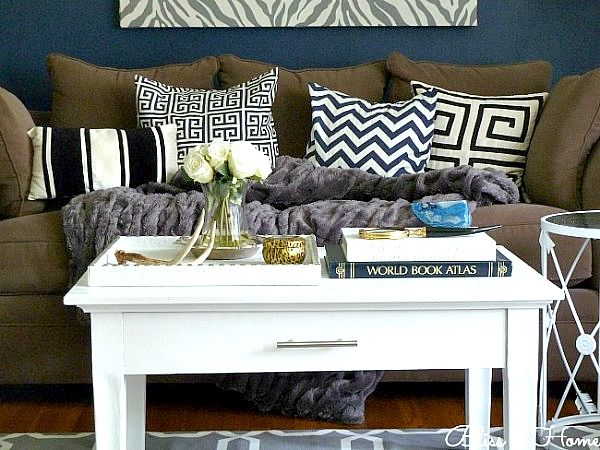 dark blue walls and cute coffee table arrangement