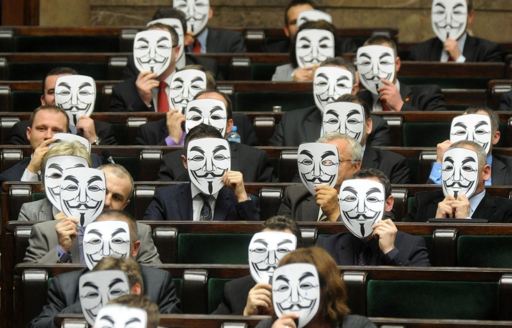 """""""Anonymous in Polish parliament"""". -- Lawmakers from the leftist Palikot's Movement cover their faces with masks as they protest against ACTA, or the Anti-Counterfeiting Trade Agreement, during a parliament session, in Warsaw, Poland, on January 26, 2012, after the Polish government signed the agreement. Poland's plans to sign ACTA sparked attacks on Polish government websites and street protests in several Polish cities this week. (AP Photo/Alik Keplicz) via theatlantic #Poland…"""