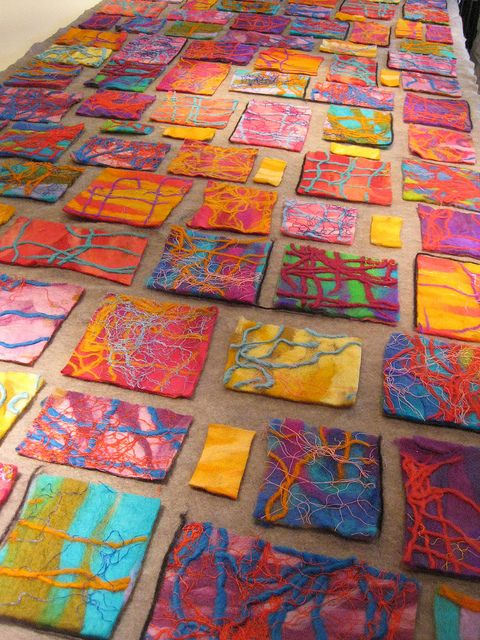 Elizabeth Armstrong, artist in residence at a grammar school, pre-k and 1st graders layout stage before wetfelting