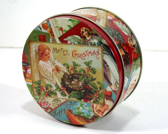 Im a sucker for vintage tins. This one is a nod to a Victorian Christmas. It is made to look like a collage of turn of the century Christmas cards.