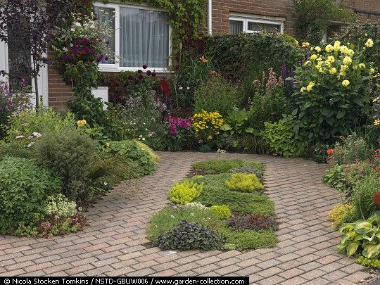 Paving Designs For Front Gardens conifer garden design ideas for front yard front gardens ideas small yards Small Front Garden Is Paved For Off Street Parking Cars Straddle Beds Of Low