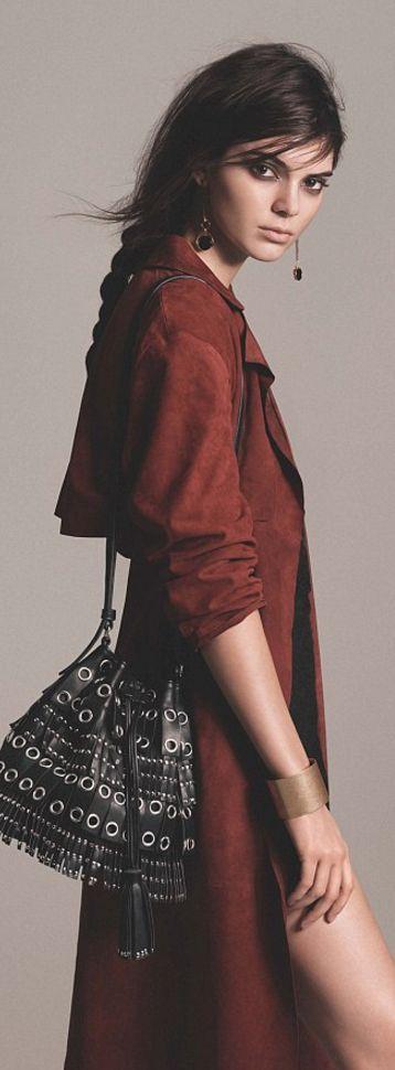 Who made  Kylie Jenner's red suede coat, black fringe bucket handbag, and dangle earrings?
