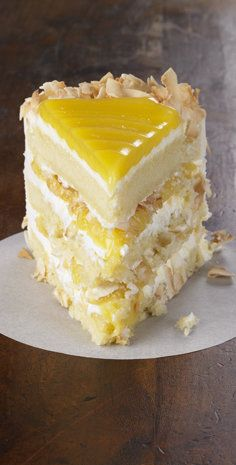 Recipe for Lemon Coconut Cake - Tangy lemon filling between layers of tender white cake. Top it all off with a rich coconut-cream cheese frosting.