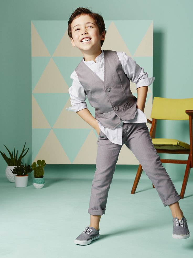 The outfit Boy's Linen & Cotton Waistcoat + Boy's Striped Shirt with Mandarin Collar + Boy's Linen & Cotton Trousers + Boy's Low Top Canvas Trainers -