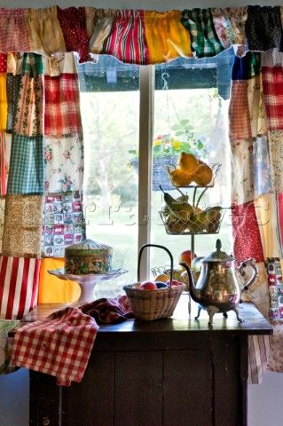 Silver Teapot With Fruit On Side Unit Patchwork Curtains In Essex Home