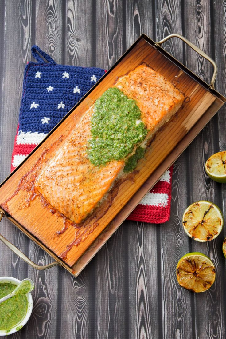 Cedar plank salmon with cilantro pest and grilled limes!